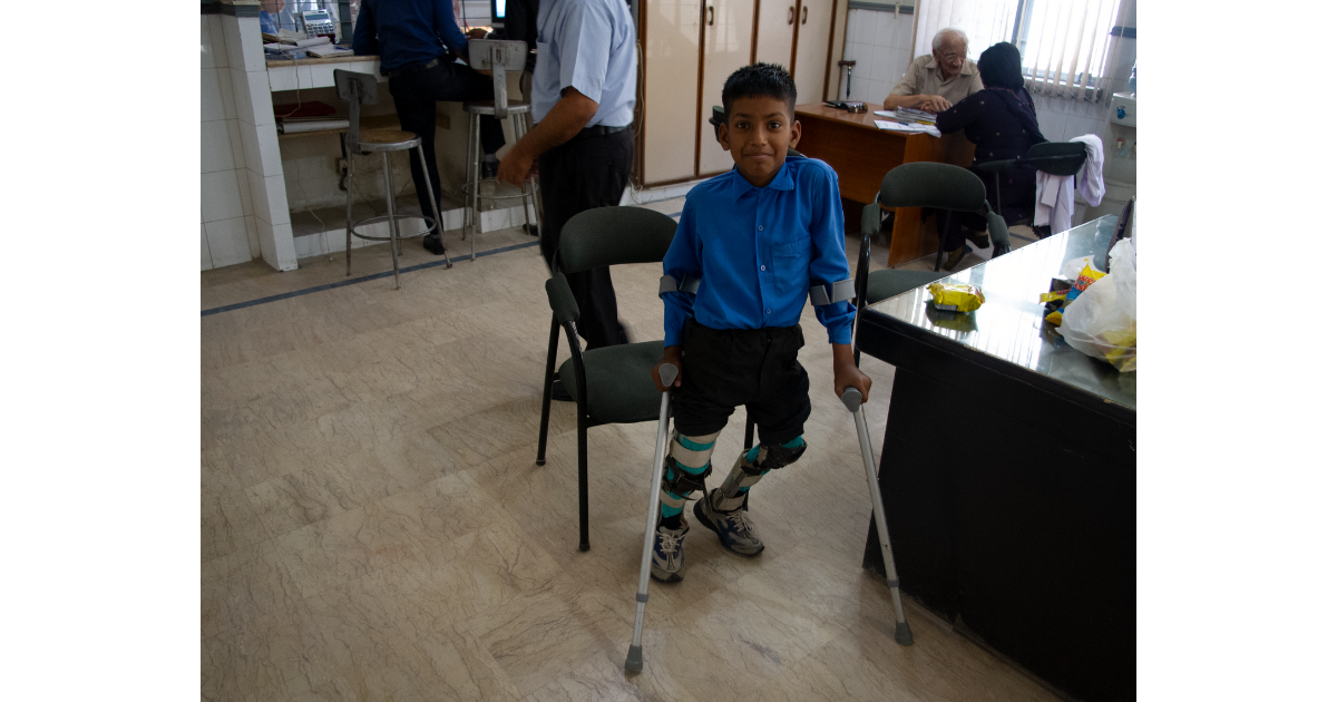 Child with Crutches Smiling